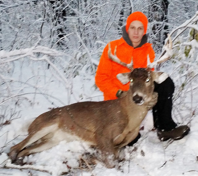 Austin Smith took his 1st buck during shotgun season in Woodford County.