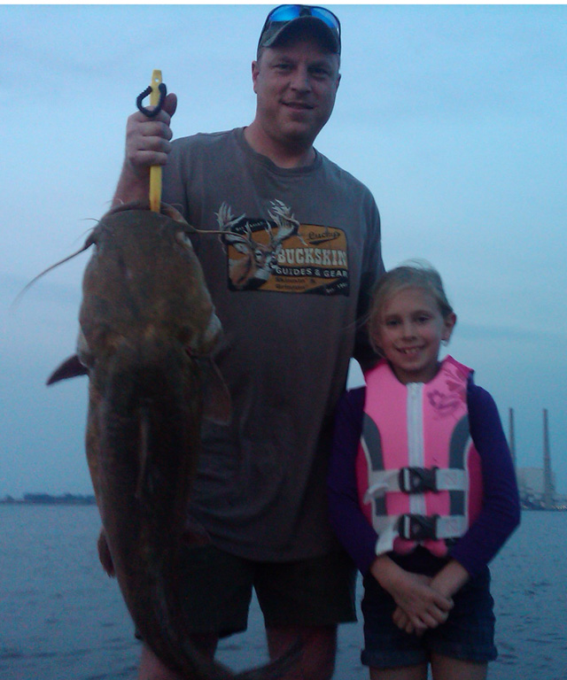 Bill Ziebold and his daughter, Taylor, caught this flathead catfish while fishing at the Baldwin Lake cooling plan reservoir.