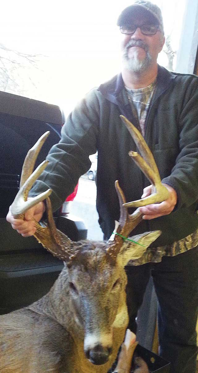Bowhunter Kevin Moore rattled this Tazewell County 8-point buck to within 15 yards on Nov. 11
