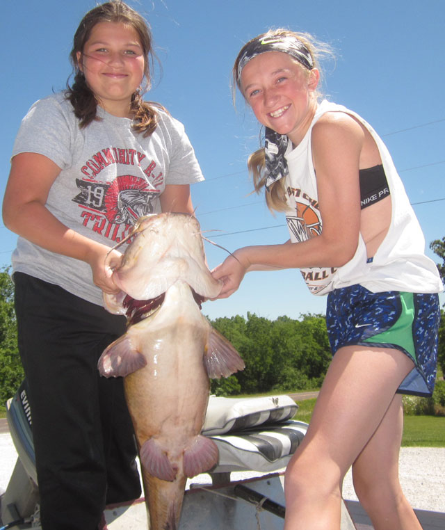Brianna and Bryanna Beamer hoisting the 30# flathead they helped catch June 30 at Mark Twain Lake. Photo courtesy THE DRY DOCK. Heartland Outdoors