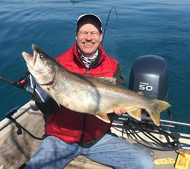 Chris Popp on Catchem Plenty III caught this lake trout in April of 2016 off Waukegan
