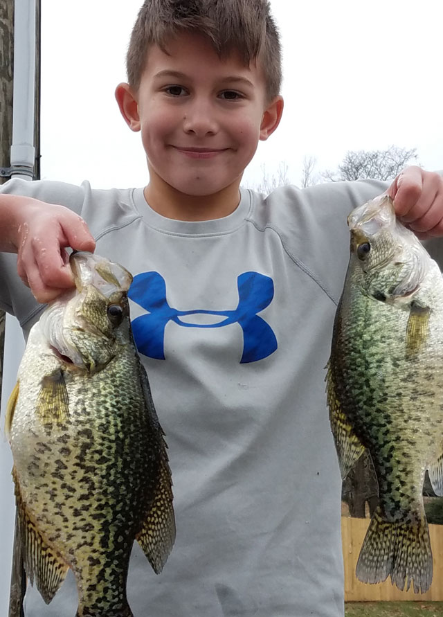 Cole Panick hoists two crappie he caught in southern Illinois in February