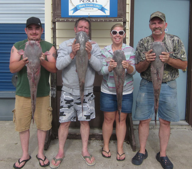 Dustin Plum, Mike Pendleton, Sabrina Plum and Greg Monroe with some nice blue catfish caught June 12 that weighed 22, 18,16 and 19 pounds. Photo courtesy of SOUTH FORK RESORT.