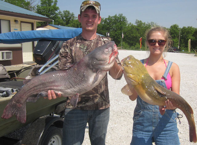 Erick Luebbert and Caty Eisterhold with the 30-pound blue catfish and 18-pound flathead they caught on Mark Twain Lake. Heartland Outdoors