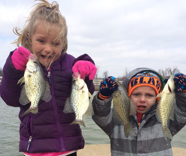 Gabby, 5, and Cooper, 3, Wisher show off some crappie they caught on a chilly March morning at a Quincy farm pond.