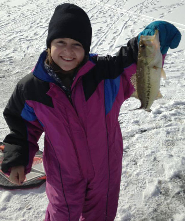 Gillian Rauch, 8, of Manteno shows the joy of ice fishing.
