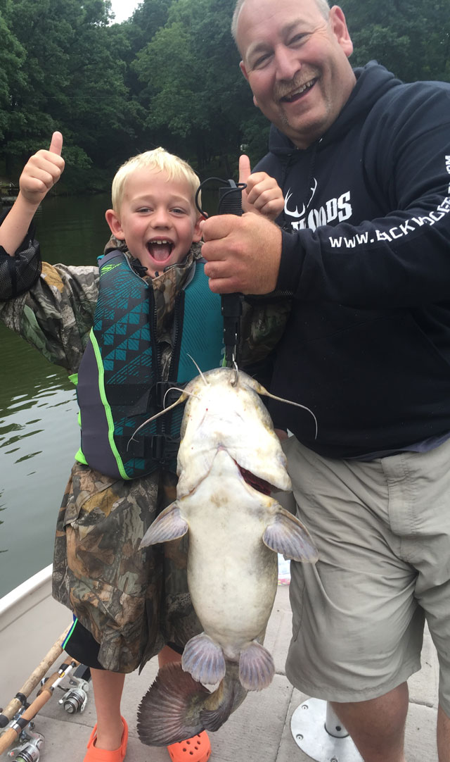 HO writer Matt Cheever and his son Joe are pleased with a 20-pound flathead Joe caught over the July 4th weekend on a crappie jig and 4-pound test line on Pana Lake.