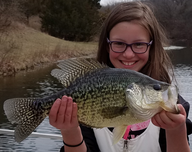 Haley Barth of Peoria caught this 18-inch, 3.2-pound crappie in a Fulton County farm pond on March 12