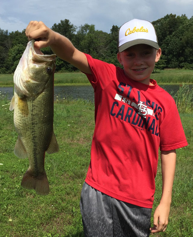 Jackson Stevens, 12, caught and released this 5-pound bass on his uncle's farm in Macoupin County on July 14