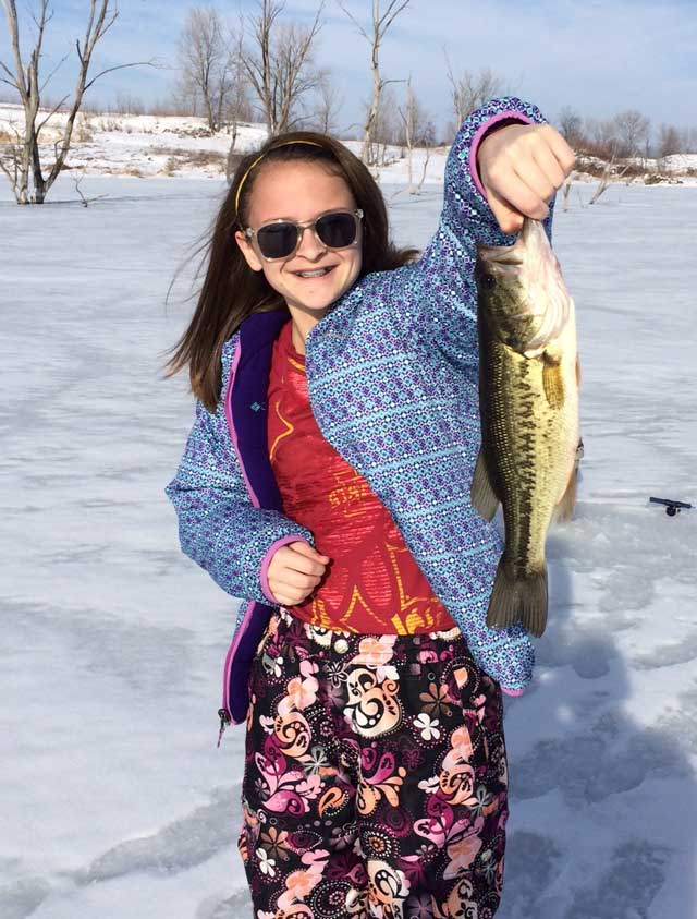 young girl from Morton caught a bass while ice fishing in February.Illinois
