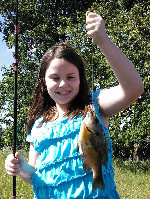 Kacyn Featherlin, 10, caught this bluegill out of a Schuyler County farm pond on a dew worm.
