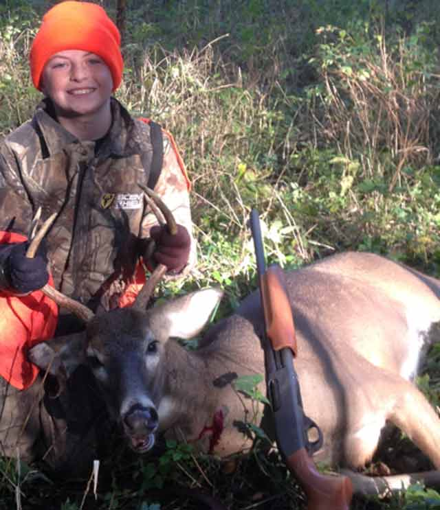 Kaden Griswold, 10, with his first deer shot Oct. 9 in Livingston County during the youth hunt