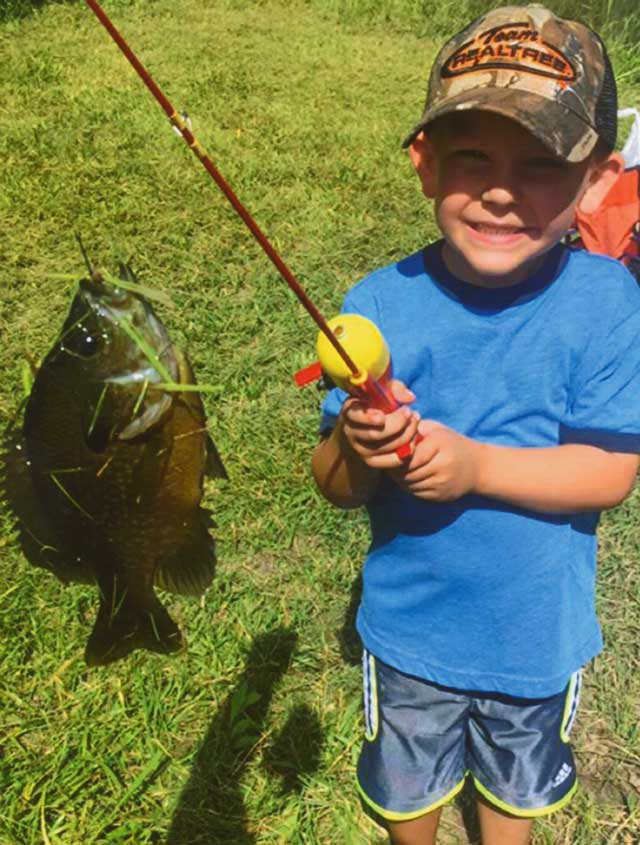 Kaynen Hall, 5, of Montrose caught his first big bluegill at his grandpa's pond.