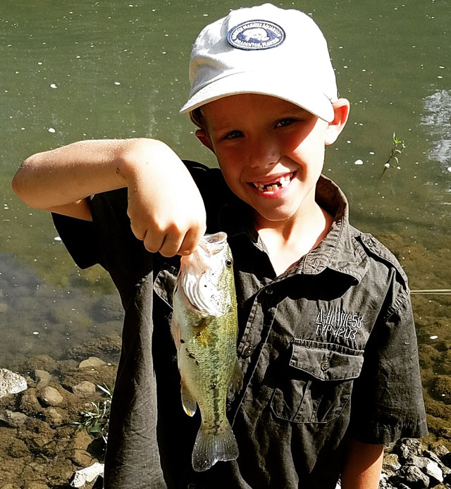 Konnor White, 8, of Cornell caught this largemouth on a lure out of the Vermillion River. He just started using lures!