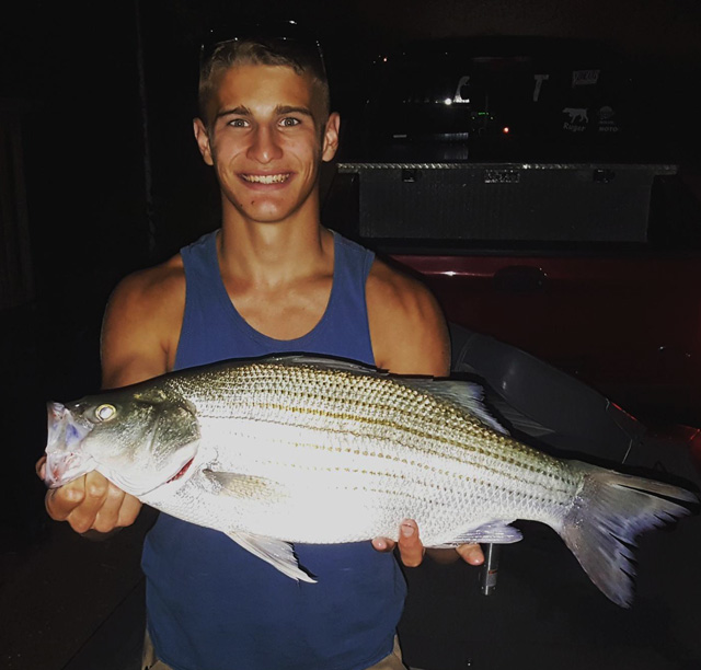 Kyle alliss caught this 6.53-pound, 25-inch hybrid striped bass at Lake Bloomington in late June. Photo courtesy of PRESLEYS OUTDOORS