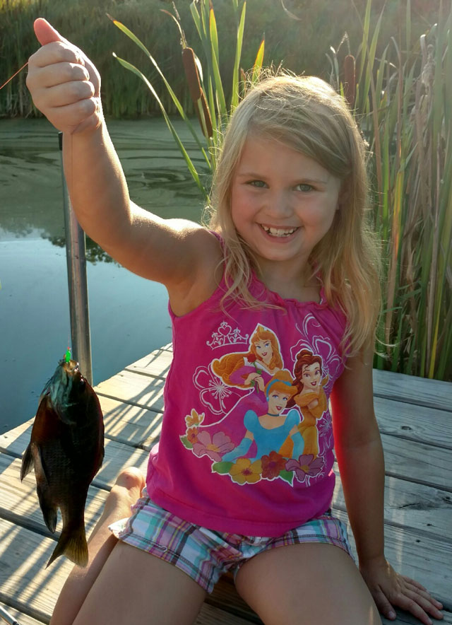 Lucy Teal of Canton caught this bluegill on a waxworm while fishing with her father in early August.
