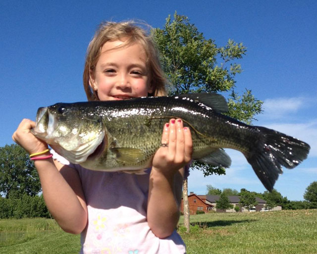Mackenzie-Stage,-7,-of-Brimfield-caught-this-big-Peoria-County-farm-pond-bass-in-early-June.