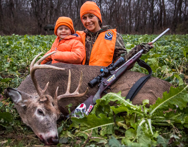 "Michelle Bullard shot this Tazewell County buck on the second day of the last Illinois gun season. She is pictured with 4-year-old son, Zane. Her hunt will be featured on ""Fear No Evil"" on the Outdoor Channel"