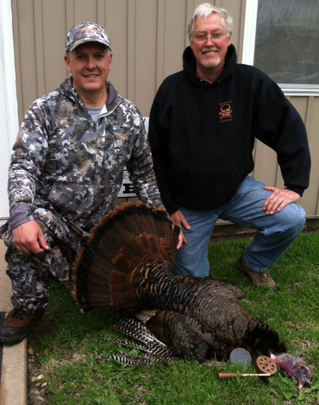 Mike Danner (left) with a nice Fulton County turkey and Stan Brown of Poison Turkey Calls.