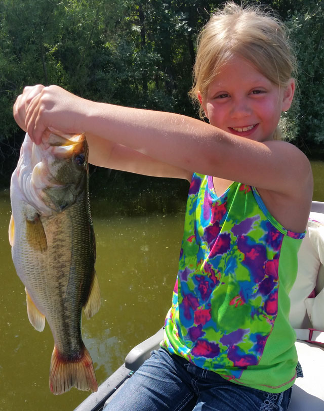 Morgan Voss caught this big farm pond bass in Adams county fishing with her dad, Raymond.