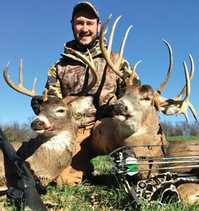 Nate Wade poses with the two Hancock County bucks he shot last fall in Illionois on back-to-back days. The buck on the left is a gun kill and the buck on the left is a bowkill