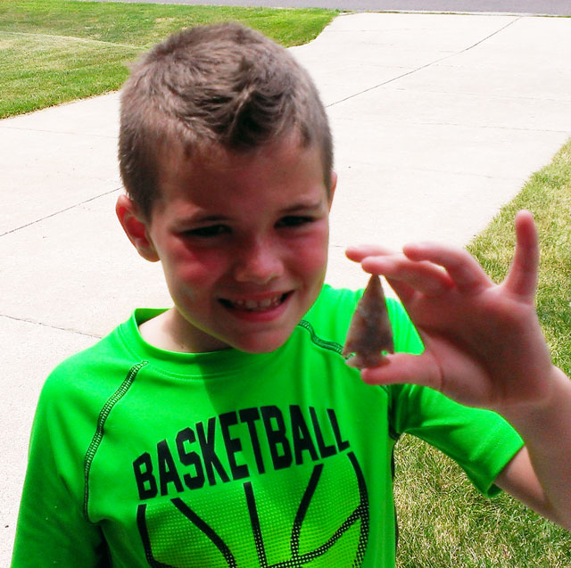Noah Collins proudly displays an arrowhead he found while hunting with his grandfather, Lummy Collins