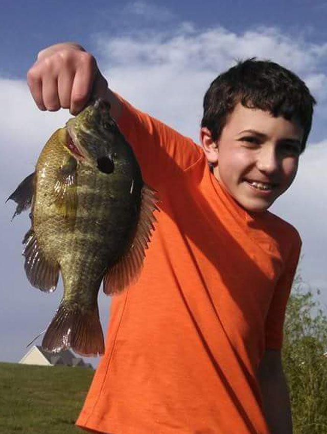 Nolan Herman of Dahinda caught this nice bluegill while fishing at Oak Run's Spoon Lake.