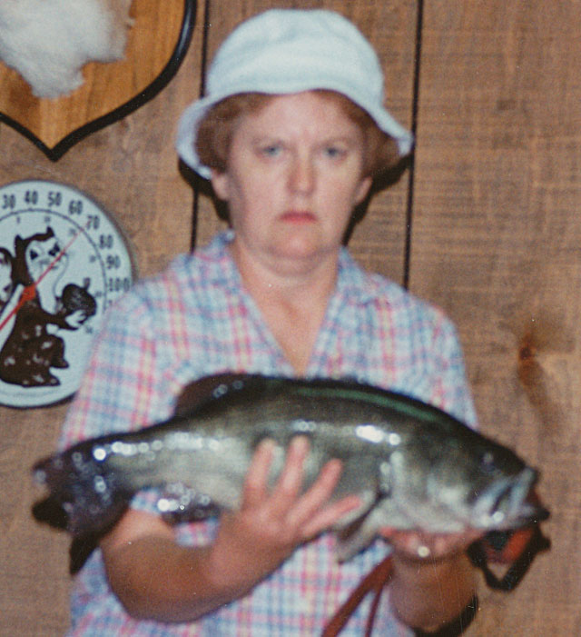 Norma Hanley of Kickapoo holds up a 5-pound bass she caught out of a Peoria County pond in the 1980s