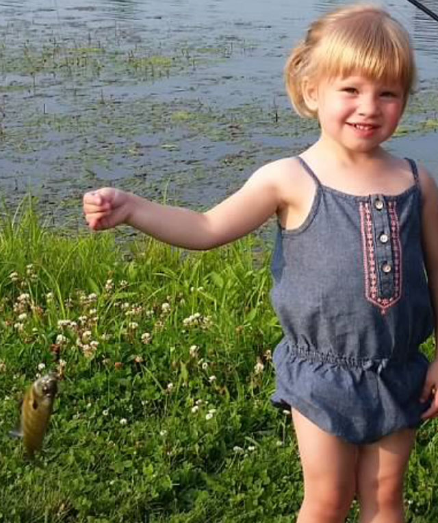 Ryan Wolter, 2, caught her first bluegill this summer in Macon County with help from her parents.