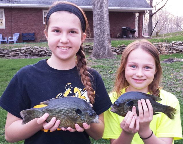 two girls with a couple of nice bluegill they caught in a strip pit outside of town.(Canton)illinois