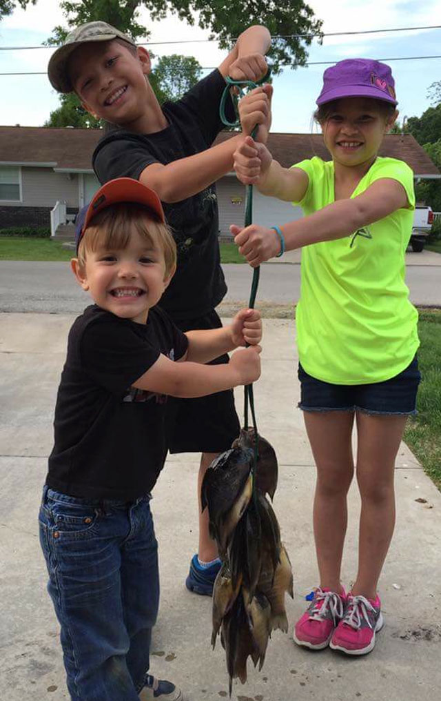 Pictured are Kael (front), Kayden (back left) and Kaylie Koeberlein of Effingham after a fwith their dad, Jeremiah.