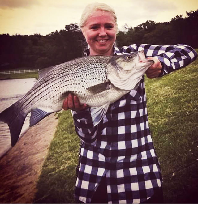 Shiloh Lueschow of Elmwoodcaught this hybrid striped bass May 21 at Spring Lake near Macomb on a half-ounce spoon. Heartland Outdoors