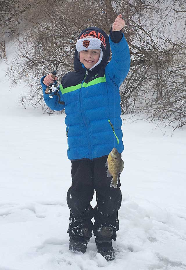Brody Child ice fishing bluegill