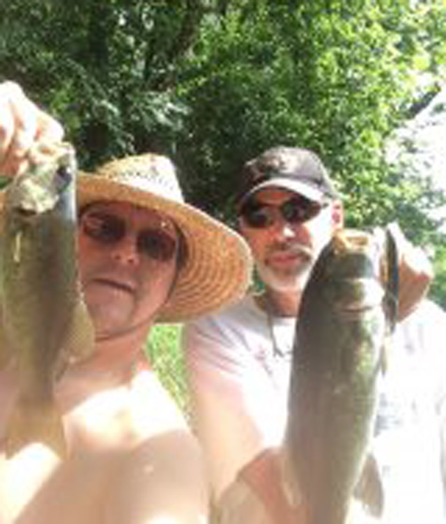 arren Morgan, Ellsworth (left) and Tad Bonham, Bloomington (right) enjoying a Bronzeback double on a Central Illinois river.