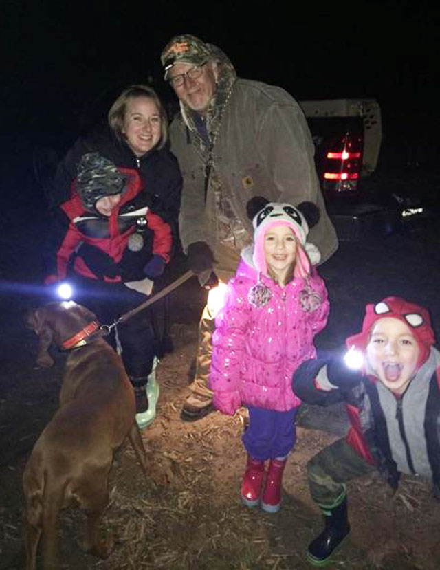Papa Steve Dykstra taking 5 year old twin grandkids Owen and Lucy with Mom Janelle and grandson Caleb age 3 and his dad Dan on the grandkids first coon hunt with redbone Annie.
