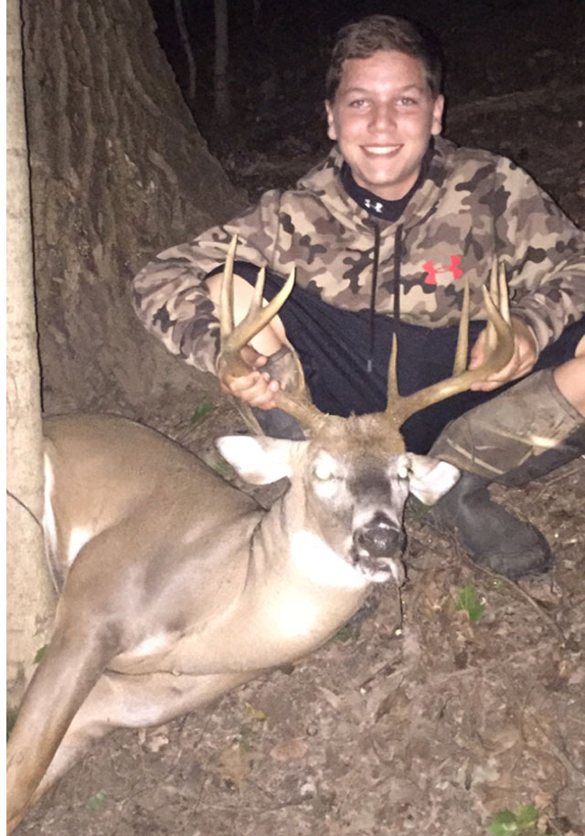 Fw_ 13 year old conner christain with his first deer taken oct 1 in marshall county