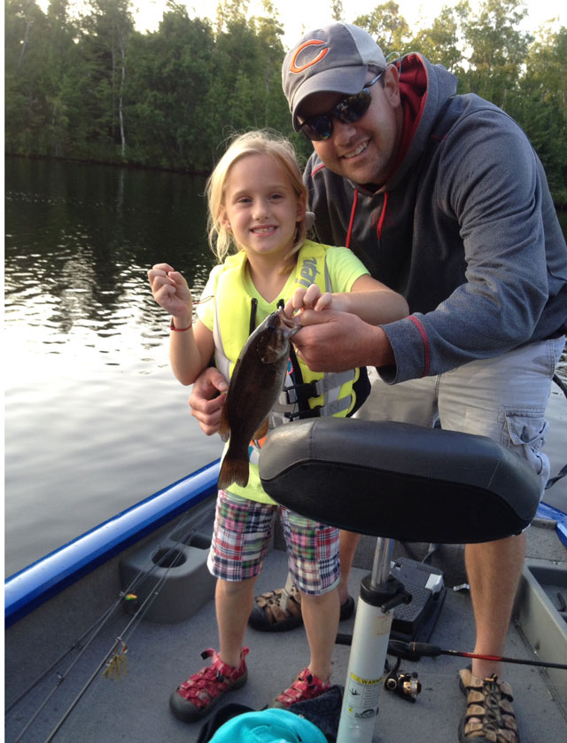 7 year old from Peoria catches here first small mouth bass from the Chippewa Flowage in WI