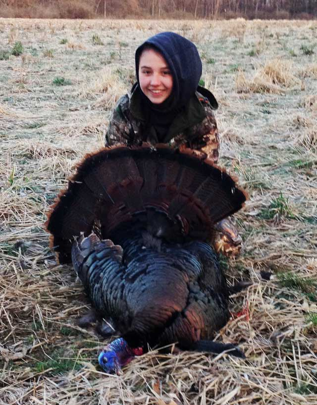 girl shot turkey with 9.5 in beard and it weighing 21.5 pounds. illinois
