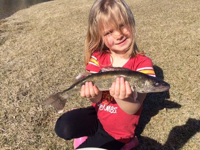 Gabby, with her very first walleye. She caught it this afternoon all by herself; no more help from dad needed.