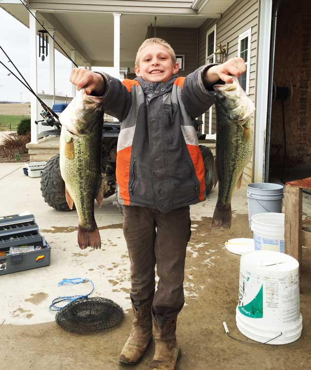 boy of rural Secor, IL caught these monster bass along with many others as he and his siblings enjoyed spring break farm pond fishing this week
