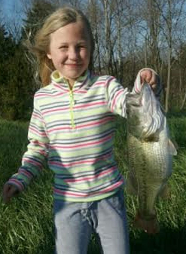 Savannah Harrison caught this big bass from a rural pond near Nashville, Illinois on April 3, 2016 using a gold bladed spinnerbait with a black/blue skirt.  The bass weighed 3 pounds 7 ounces and was released after the photo was taken.