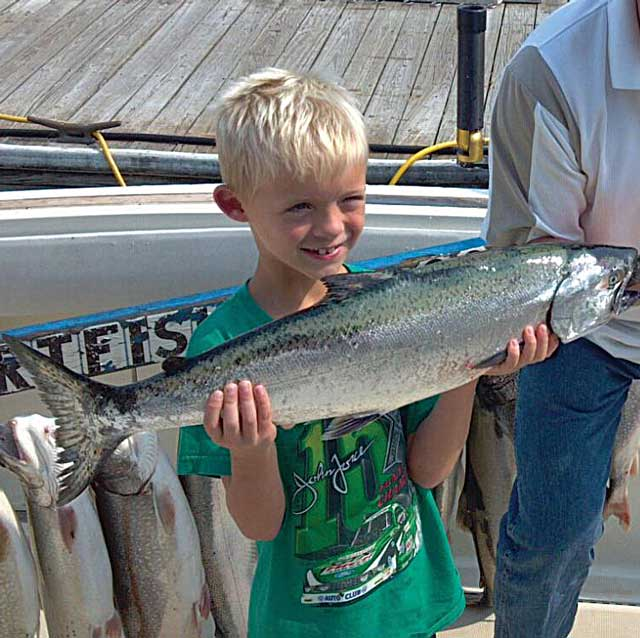 Kid with first salmon
