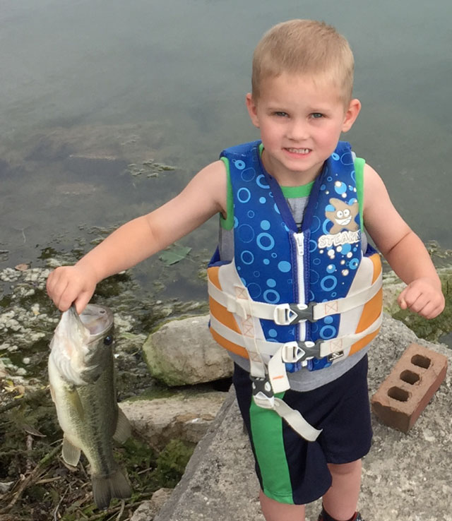 Owen Henkel (4) of Fairbury caught his first fish by himself on May 31.  He was cranking a shallow running square-billed crankbait when this largemouth made his day. Despite many cries to eat it, his daddy made him release it.  He plans on catching it again.