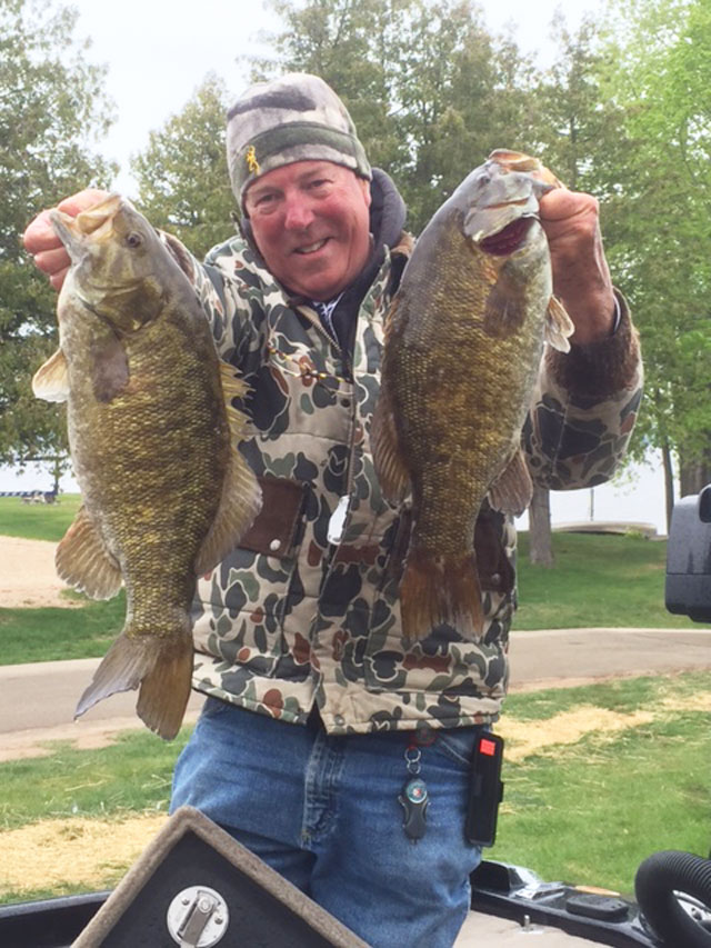 Man of rural Farmington caught these two hefty smallmouth bass in early June while fishing Wisconsin's famed Sturgeon Bay